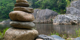 stones erected beside water, a photo from adventistreview.org, suggestive of the context of today's first reading from Joshua 5