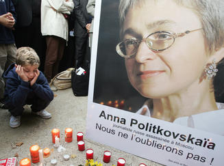Mourners honoring Anna Politkovskaya, Russian journalist and regime critic, assassinated October 7, 2006